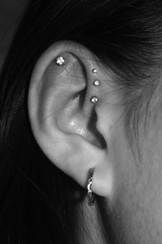 elegant ear styling with a hoop in the lobe, studs in the flat and forward helix