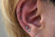 layered piercings – lobe, flat, snug and helix ones for a chic look