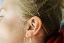 minimalist ear styling with a large hoop and a smaller stud is a chic idea for a modern gal