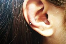 minimalist ear styling with a snug piercing and a simple earring