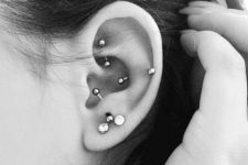 multiple piercings – lobe, anti tragus, rook and snug ones with matching earrings
