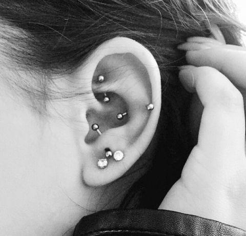 multiple piercings - lobe, anti tragus, rook and snug ones with matching earrings