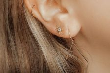 stylish piercings – a helix, lobe and forward helix one with chic gold earrings