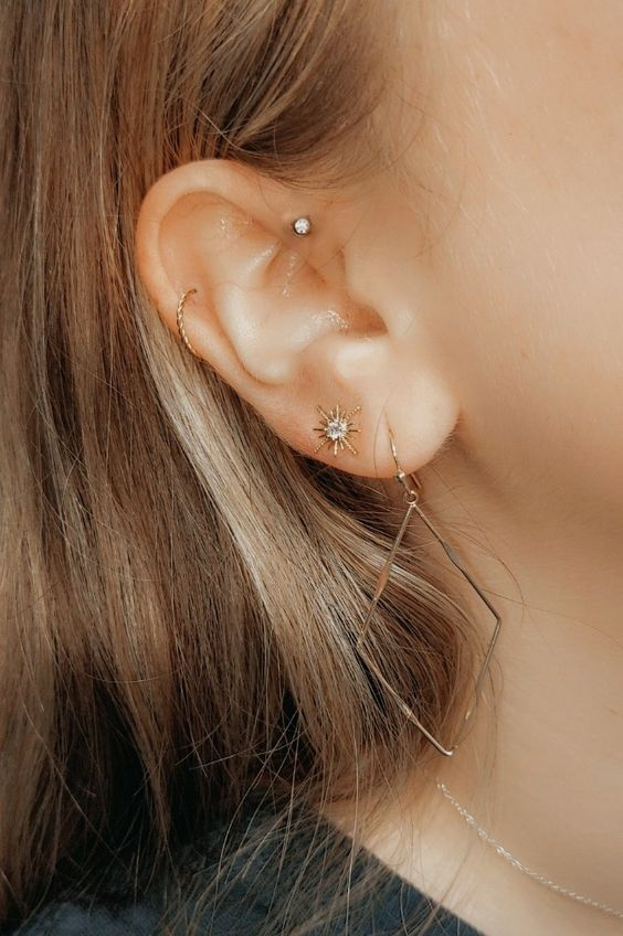 stylish piercings - a helix, lobe and forward helix one with chic gold earrings