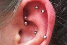 stylish rook, snug and flat piercings done with matching earrings for a modern feel