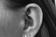 trendy ear styling with two lobe piercings and a hoop in the forward helix is very edgy
