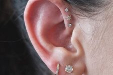 two lobe piercings paired with three forward helix ones for a bold modern look