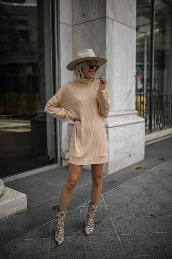a tan sweater dress, snakeskin print booties, a white wide-brim hat for this fall