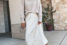 03 a neutral fall look with a grey sweater, a white slip skirt, grey booties and a wide-brim hat