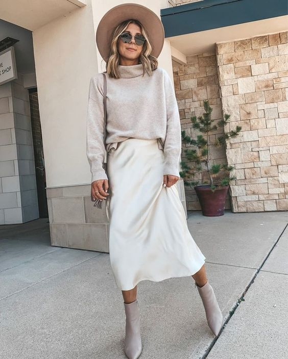 a neutral fall look with a grey sweater, a white slip skirt, grey booties and a wide-brim hat