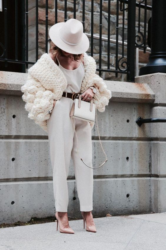 an elegant and chic fall look with a white top, pants, nude shoes, a creamy chunky knit cardigan and a white hat