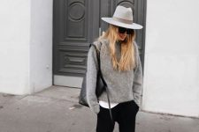 06 a white tee, black pants, a grey cashmere sweater, white sneakers and a white wide-brim hat