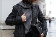 08 a monochromatic look with a grey hoodie, a grey plaid blazer, black jeans, a black bag and a grey beanie