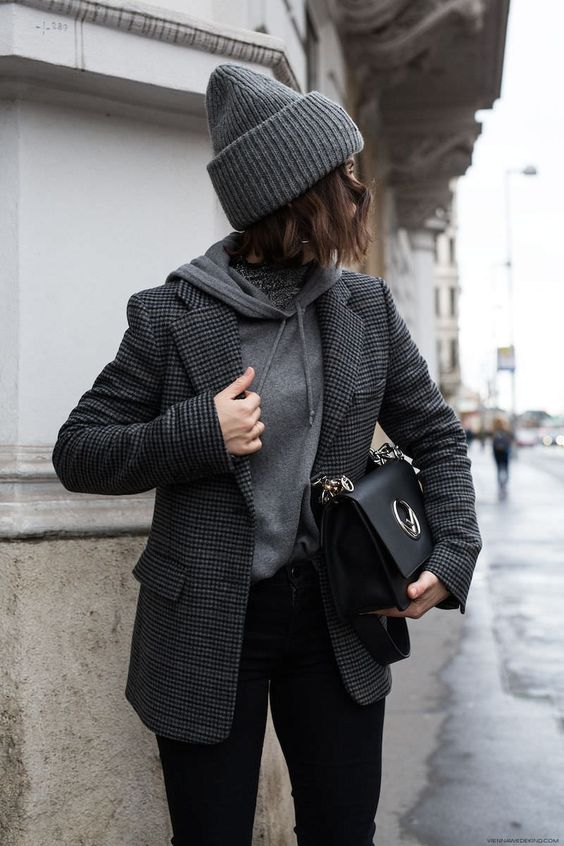 a monochromatic look with a grey hoodie, a grey plaid blazer, black jeans, a black bag and a grey beanie