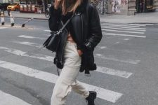 10 a winter look with white cargo pants, black boots, a black shearling coat, a beanie and a bag