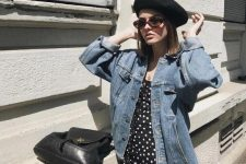 11 a black polka dot dress, an oversized denim jacket, a black beret, sunglasses and a black backpack