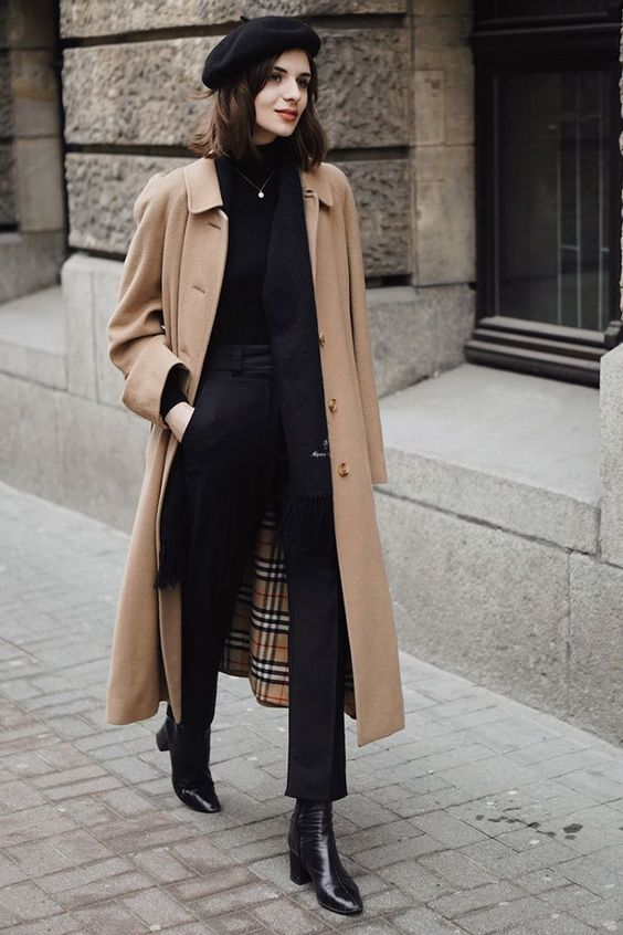 a fall work look with a black turtleneck, pants and booties, a tan coat, a black beret