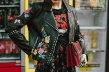 15 a black printed tee, a black floral midi skirt, a red bag and a black painted leather jacket plus a military cap