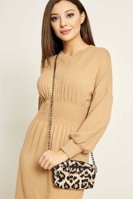 With beige long sleeved dress