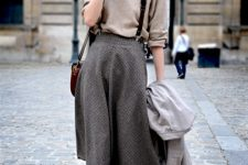 With beige sweater, gray coat and gray tweed skirt