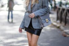 With beige turtleneck, beret, checked blazer, chain strap bag and leather mini skirt