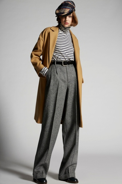 With black and white turtleneck, brown coat, black flat boots and cap