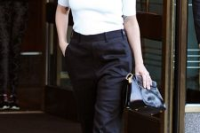 With black high-waisted trousers, black clutch and pumps