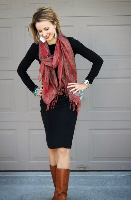 With black knee-length dress and brown high boots
