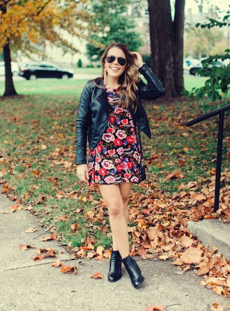 With black leather jacket and black ankle boots