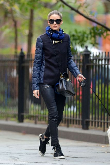 With black leather pants, black crossbody bag and sneakers
