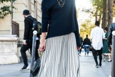 With black loose turtleneck and ankle strap shoes