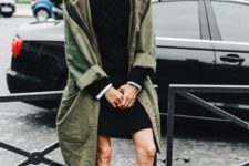 With black mini dress and olive green loose coat