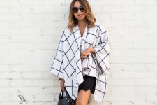 With black mini skirt, bag and cutout boots
