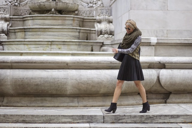 With black pleated skirt, ankle boots, black tote bag and jacket
