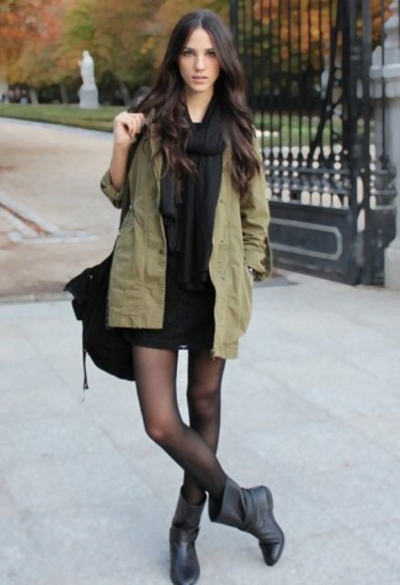 With black scarf, black mini skirt, olive green jacket and bag