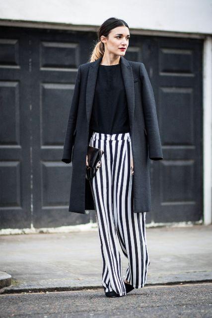 With black shirt, black clutch, black coat and high heels