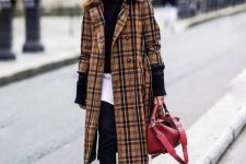 With black trousers, red bag, embellished boots, white shirt and black jacket