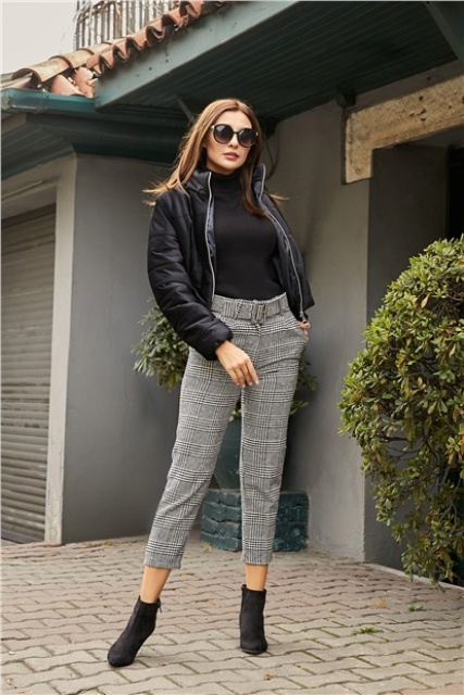 With black turtleneck, black jacket and suede ankle boots