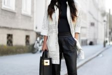 With black turtleneck, black leather pants, tote bag and high heels