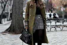 With black turtleneck, checked wrap mini skirt, black ankle boots and black leather bag