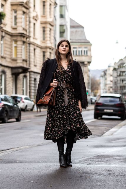 With brown bag, black high boots and black fur sleeved jacket