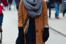 With brown coat, black dress and crossbody bag