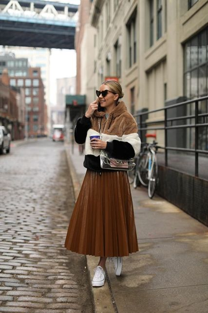With brown pleated midi skirt, transparent bag and white sneakers