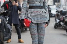 With checked flare trousers, red clutch, black belt and printed shoes