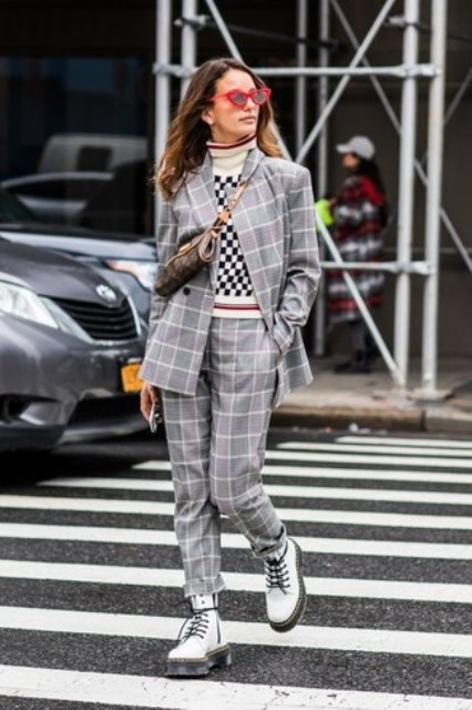 With checked turtleneck, gray printed suit and printed bag