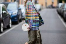With colorful checked blazer, white rounded bag and black platform shoes