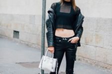 With crop top, black jacket, white bag and leather trousers