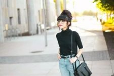 With cropped jeans, black leather bag and black flat shoes