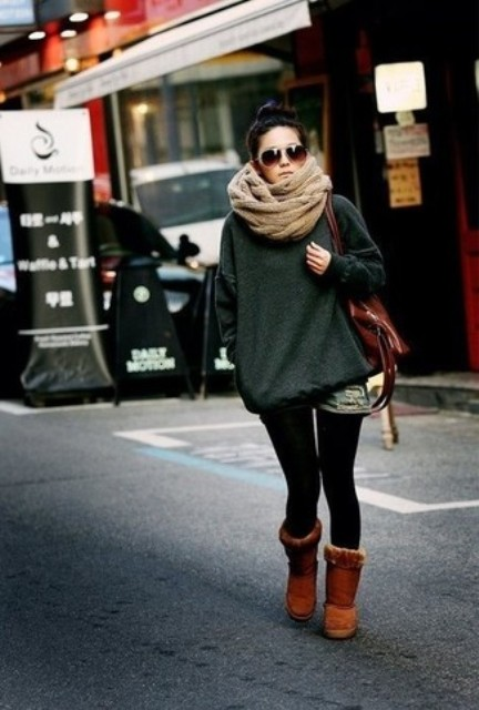 With denim shorts, oversized sweater, brown boots and bag