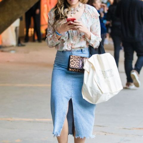 With denim skirt, white tote bag and floral ruffled blouse